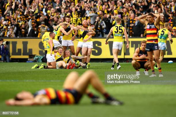 Tigers players celebrate winning the 2017 AFL Grand Final match between the Adelaide Crows and the Richmond Tigers at Melbourne Cricket Ground on...