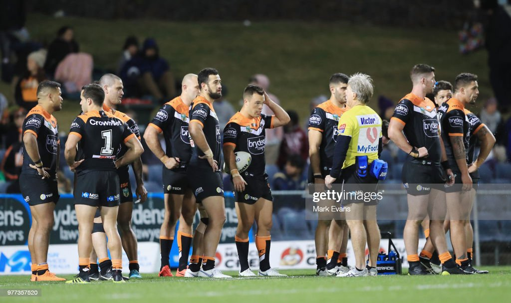 Tigers players gather after a Raiders try during the round 15 NRL match between the Wests Tigers and the Canberra Raiders at Campbelltown Sports Stadium on June 17, 2018 in Sydney, Australia.