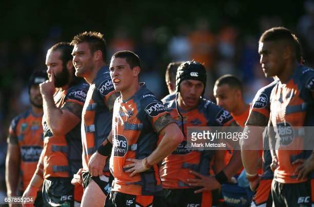 Tigers players look dejected after conceding a try during the round four NRL match between the Wests Tigers and the Melbourne Storm at Leichhardt...
