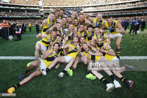 Tigers players pose with the cup after winning during the 2017 AFL Grand Final match between the Adelaide Crows and the Richmond Tigers at Melbourne...
