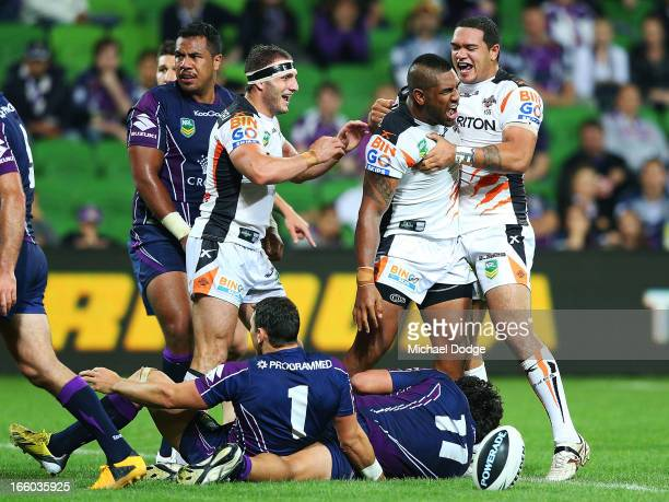 Tigers players Robbie Farah and Ben MurdochMasila react after Eddie Pettybourne scored a try that was later turned down during the round 5 NRL match...