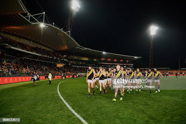 Tigers players show their dejection after defeat during the round 17 AFL match between the Greater Western Sydney Giants and the Richmond Tigers at...
