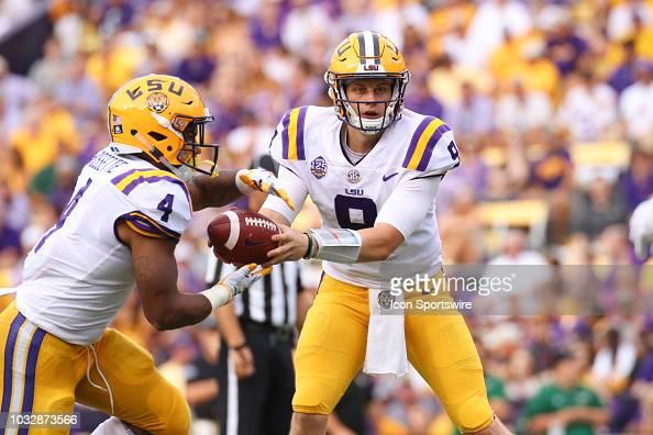 LSU Tigers quarterback Joe Burrow hands the ball off to ...