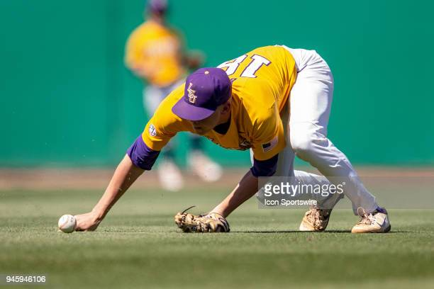 Tigers right handed pitcher Austin Bain fields a ball during a baseball game between the Mississippi State Bulldogs and the LSU Tigers on March 31...