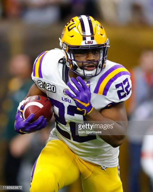 Tigers running back Clyde EdwardsHelaire rushes during the second half of the College Football Playoff National Championship Game between the LSU...