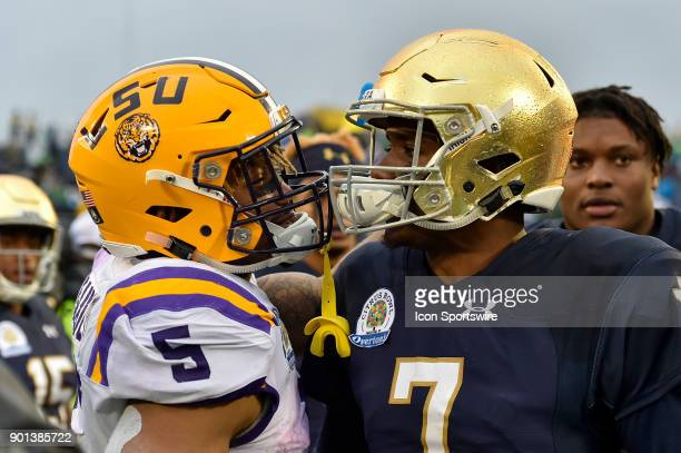 Tigers running back Derrius Guice and Notre Dame Fighting Irish quarterback Brandon Wimbush meet after the Citrus Bowl game between the Notre Dame...