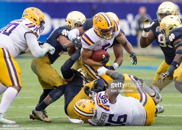 Tigers running back Derrius Guice gets tackled making the first down during the Citrus Bowl between the Notre Dame Fighting Irish and LSU Tigers on...