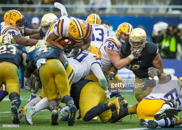 Tigers running back Derrius Guice goes over the top just short of end zone during the Citrus Bowl between the Notre Dame Fighting Irish and LSU...