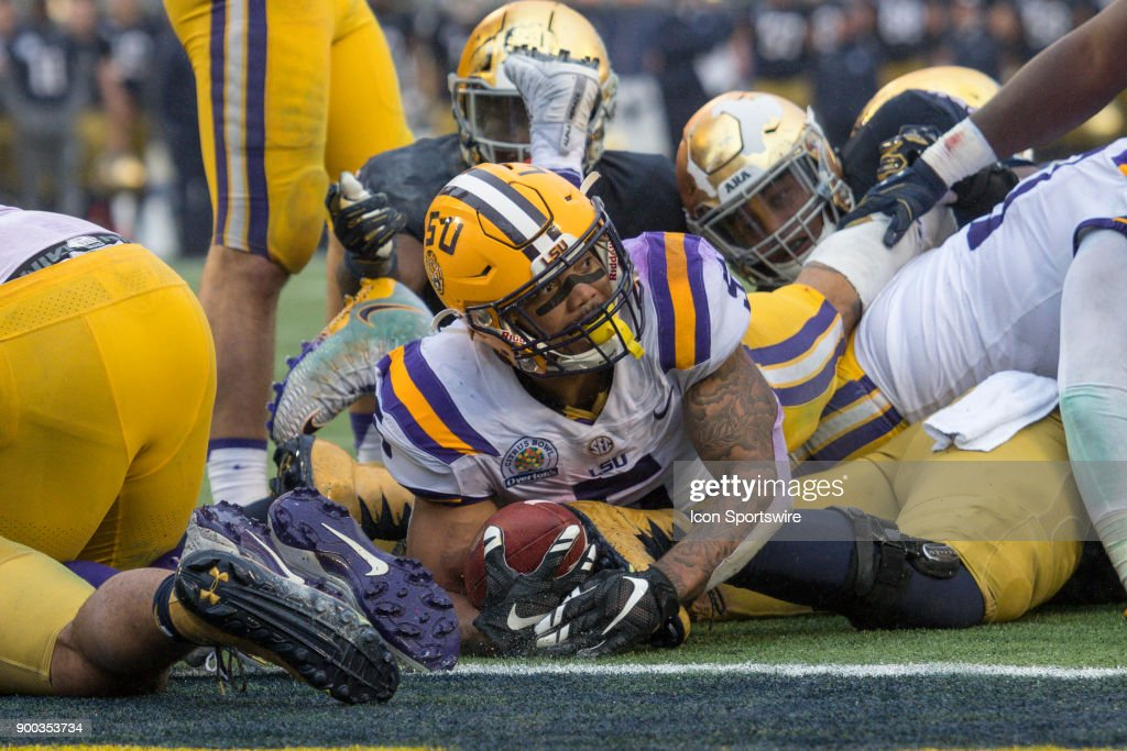 LSU Tigers running back Derrius Guice (5) is just short of the goal line as he looks to the side judge to see if he scored during the second half of the Citrus Bowl game between the Notre Dame Fighting Irish and the LSU Tigers on January 01, 2018, at Camping World Stadium in Orlando, FL. Notre Dame defeated LSU