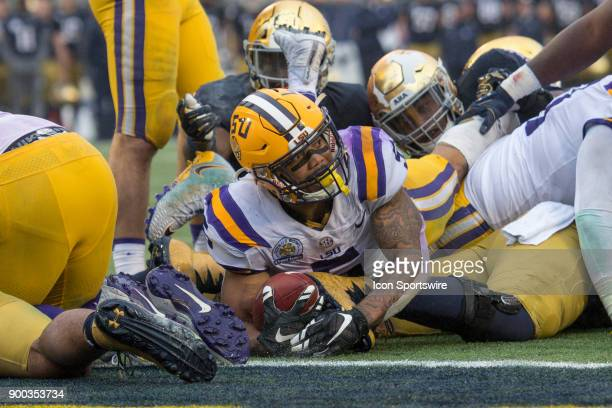 Tigers running back Derrius Guice is just short of the goal line as he looks to the side judge to see if he scored during the second half of the...