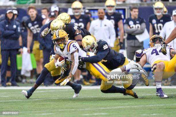 Tigers running back Derrius Guice is tackled during the first half of the Citrus Bowl game between the Notre Dame Fighting Irish and the LSU Tigers...