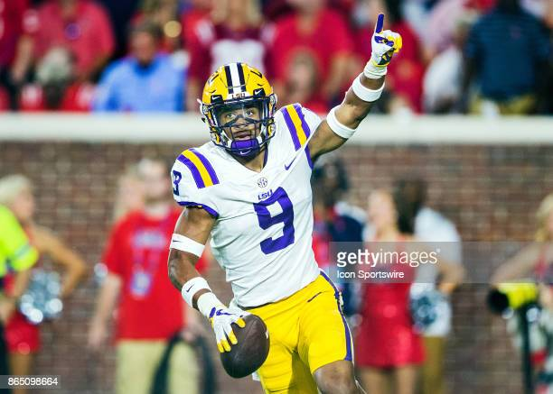 Tigers safety Grant Delpit intercepts a pass intended for Ole Miss Bears wide receiver DK Metcalf during a football game between the LSU Tigers and...