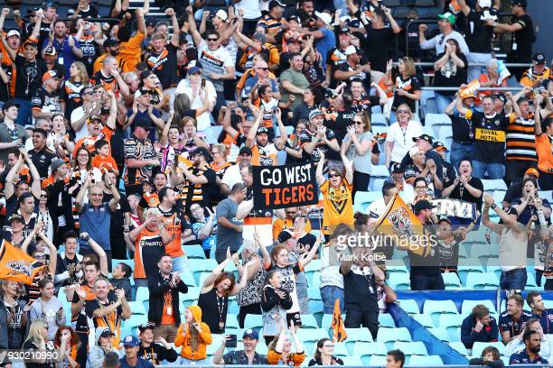 Tigers supporters cheer during the round one NRL match between the Wests Tigers and the Sydney Roosters at ANZ Stadium on March 10 2018 in Sydney...