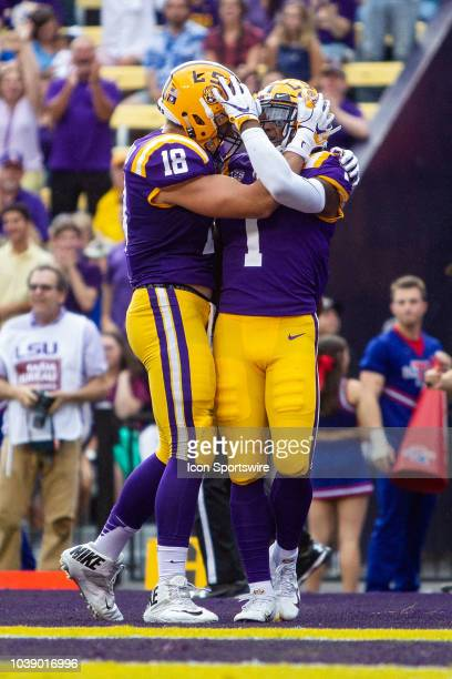 Tigers tight end Foster Moreau and Ja'Marr Chase celebrate after a touchdown during a game between the LSU Tigers and the Louisiana Tech Bulldogs at...