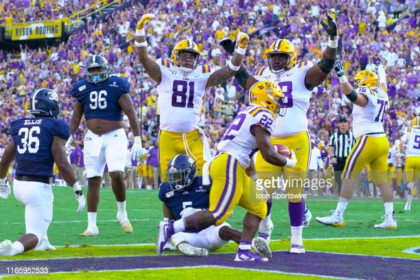 Tigers tight end Thaddeus Moss and LSU Tigers guard Damien Lewis signal a touchdown by LSU Tigers running back Clyde EdwardsHelaire during the game...