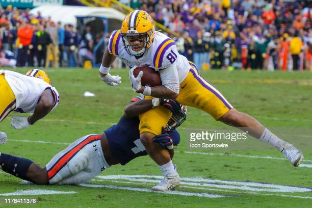 Tigers tight end Thaddeus Moss is tackled by Auburn Tigers defensive back Noah Igbinoghene on October 26 2019 at the Tiger Stadium in Baton Rouge LA