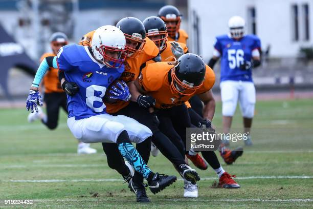 Tigers v Warriors Joy of the Warriors is tackled by players of the Warriors during the Egyptian league of American football in Cairo Egypt on 16...