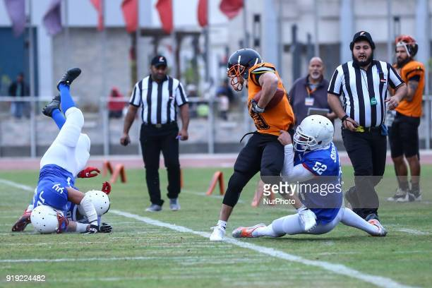 Tigers v Warriors Shoukry of the Warriors is tackles of the Tigers player during the Egyptian league of American football in Cairo Egypt on 16...