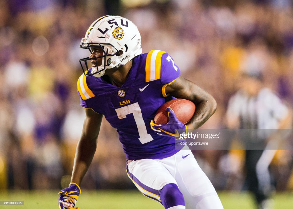 LSU Tigers wide receiver DJ Chark (7) catches a pass during a game between the LSU Tigers and Troy Trojans at Tiger Stadium in Baton Rouge, Louisiana on September 30, 2017.