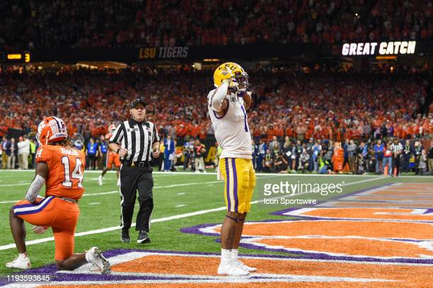 Tigers wide receiver Ja'Marr Chase celebrates a long first half pass reception to inside the five yard line during the CFP National Championship game...