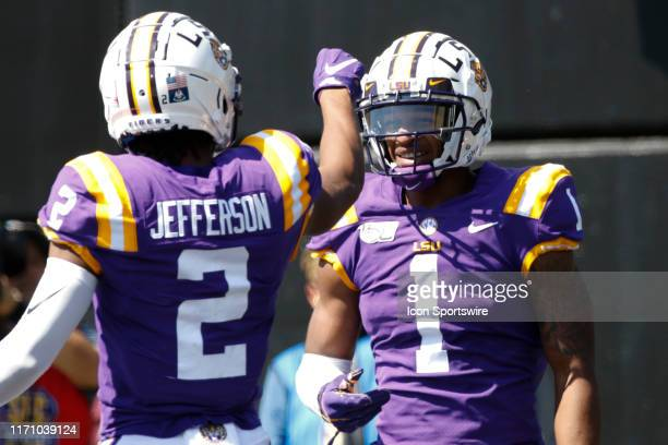 Tigers wide receiver Ja'Marr Chase is congratulated by LSU Tigers wide receiver Justin Jefferson after a touchdown during the game between the LSU...