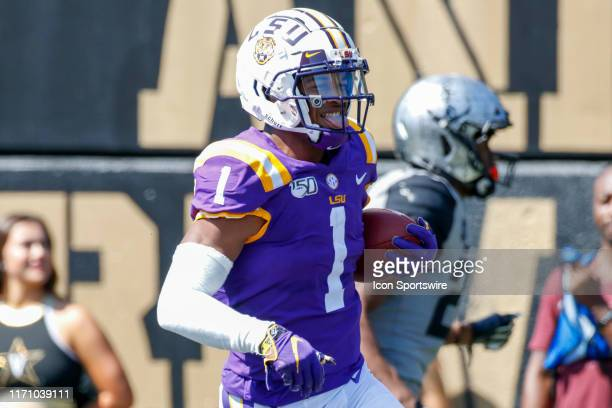 Tigers wide receiver Ja'Marr Chase reacts after a touchdown reception during the game between the LSU Tigers and Vanderbilt Commodores at Vanderbilt...