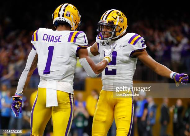 Tigers wide receiver Ja'Marr Chase reacts with wide receiver Justin Jefferson after a touchdown during the first half of the College Football Playoff...