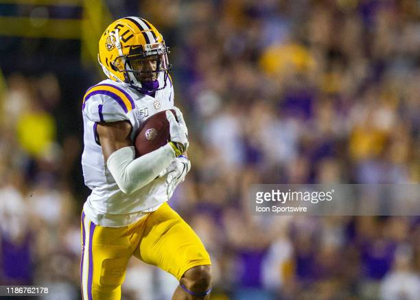 Tigers wide receiver Ja'Marr Chase scores a touchdown during a game between the LSU Tigers and the Texas AM Aggies on November 30 at Tiger Stadium in...