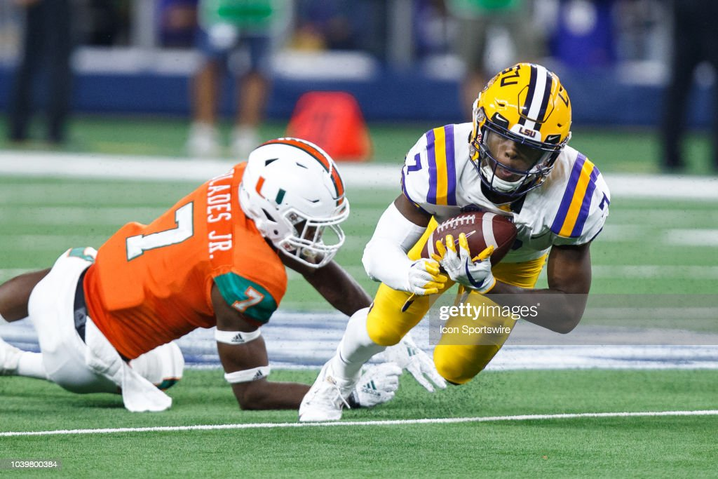 LSU Tigers wide receiver Jonathan Giles lunges forward for ...