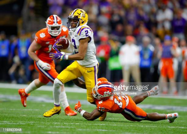 Tigers wide receiver Justin Jefferson is tackled by Clemson Tigers safety K'Von Wallace during the second half of the College Football Playoff...