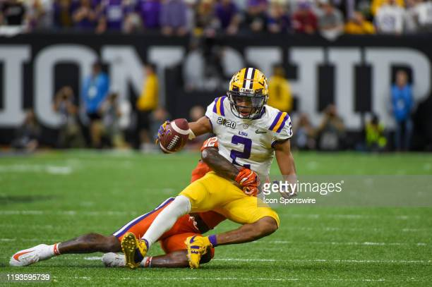 Tigers wide receiver Justin Jefferson maintains ball control as he is tackled following a second half pass reception during the CFP National...