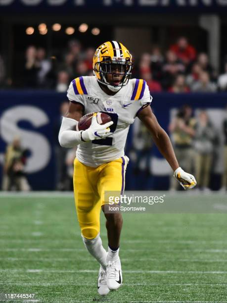 Tigers Wide Receiver Justin Jefferson rushes the ball during the SEC Championship game between the Georgia Bulldogs and the LSU Tigers on December 07...