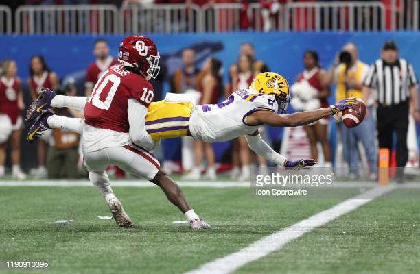 Tigers wide receiver Justin Jefferson scores the first of his four touchdowns during the ChickfilA Peach Bowl CFP Semifinal college football game...
