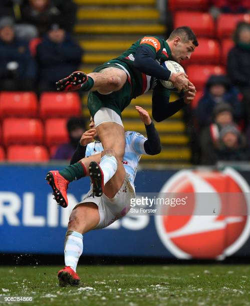 Tigers wing Jonny May is tackled in the air by Racing fullback Brice Dulin during the European Rugby Champions Cup match between Leicester Tigers and...