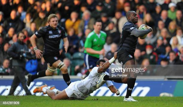 Tigers wing Miles Benjamin runs in his first try during the Heineken Cup Pool 5 round 3 match between Leicester Tigers and Montpellier at Welford...
