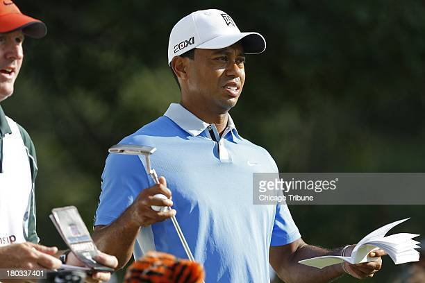 Tigers Woods stands at the 10th tee during the Gardner Heidrick ProAm held at Conway Farms Golf Club in Lake Forest Illinois on Wednesday September...