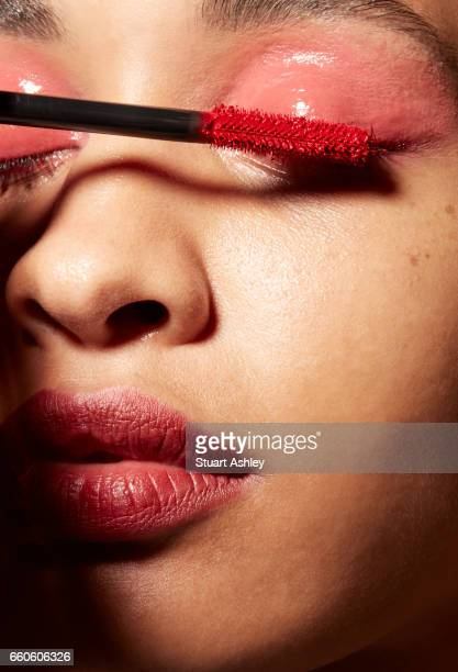 Tight beauty shot of womens face. Red lipstick, makeup and lash.