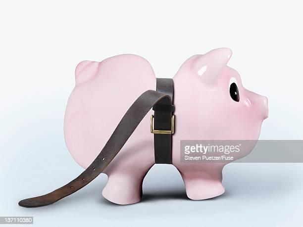 Tight belt around piggy bank