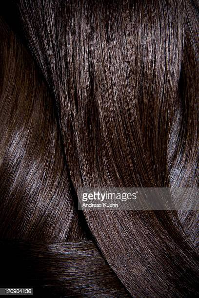 tight crop of shiny dark brown hair. - human hair stock pictures, royalty-free photos & images