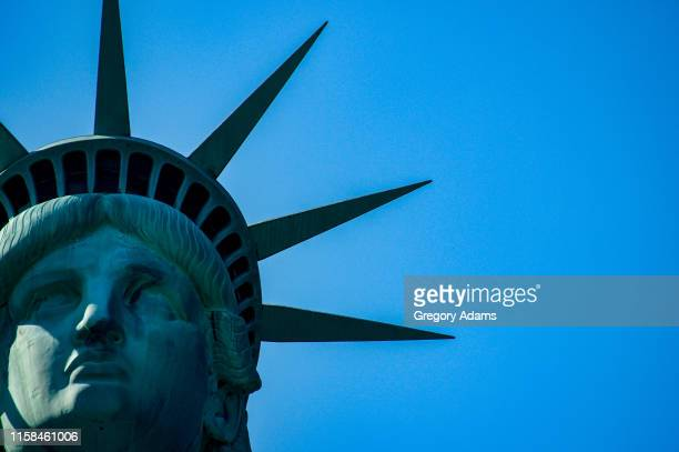 tight crop of the statue of liberty's face with room for copy - american culture stock pictures, royalty-free photos & images