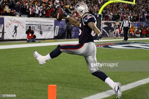 Tight end Aaron Hernandez of the New England Patriots scores a touchdown after catching a pass from quarterback Tom Brady in the fourth quarter of...