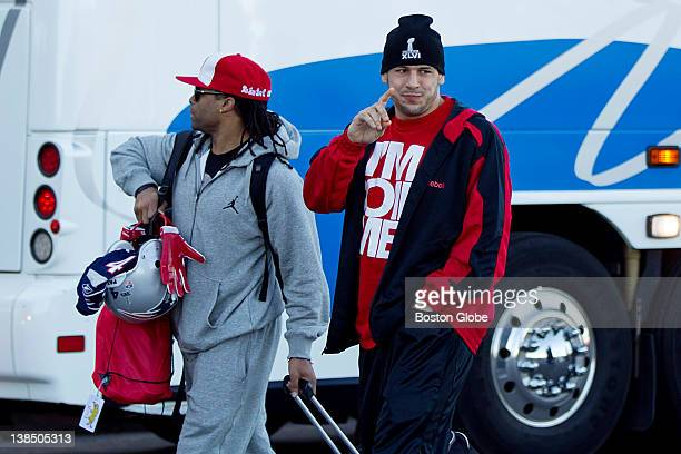 Tight End Aaron Hernandez waving walks with BenJarvus GreenEllis into Gillette Stadium New England Patriots fans gather outside of Gillette Stadium...