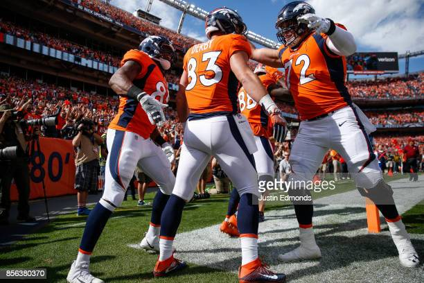 Tight end AJ Derby of the Denver Broncos celebrates with Demaryius Thomas Virgil Green and Garett Bolles after a first quarter touchdown against the...