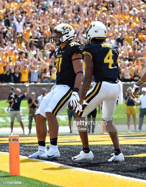 Tight end Albert Okwuegbunam of the Missouri Tigers celebrates his touchdown reception with wide receiver Jonathan Nance against the West Virginia...