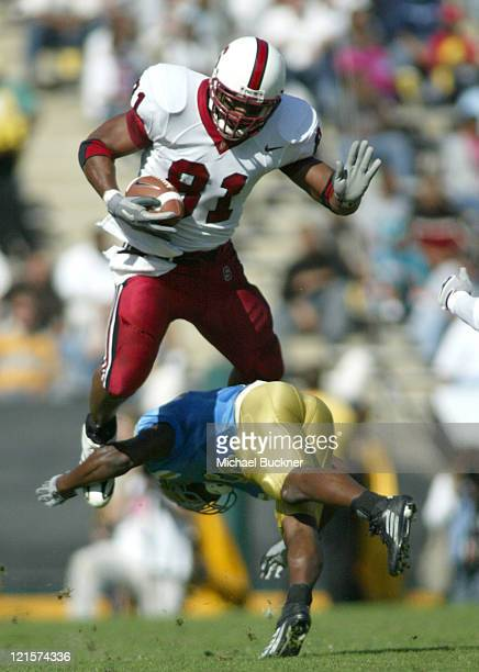 TIght end Alex Smith of Stanford University is upended by UCLA cornerback Matt Clark during the third quarter at the Rose Bowl in Pasadena Calif on...