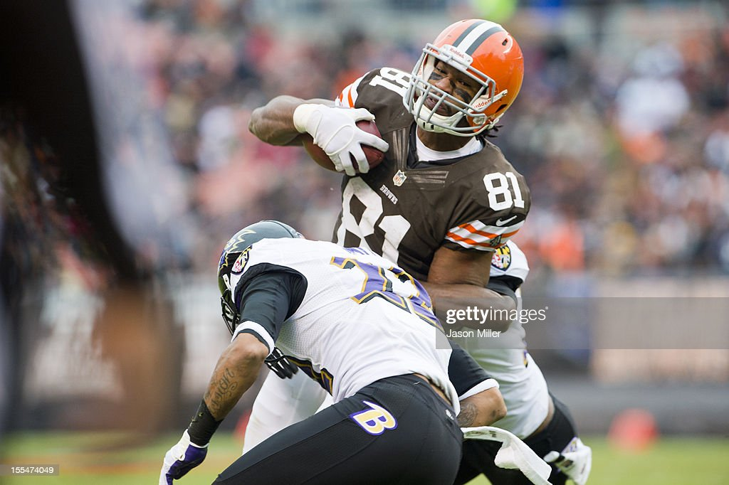 Tight end Alex Smith #81 of the Cleveland Browns is tackled by cornerback Jimmy Smith #22 of the Baltimore Ravens during the first half at Cleveland Browns Stadium on November 4, 2012 in Cleveland, Ohio.