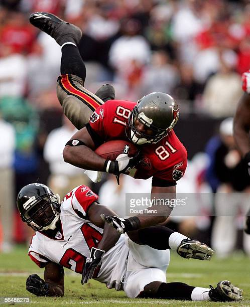 Tight end Alex Smith of the Tampa Bay Buccaneers dives for a first down over safety Bryan Scott of the Atlanta Falcons in overtime on December 24,...