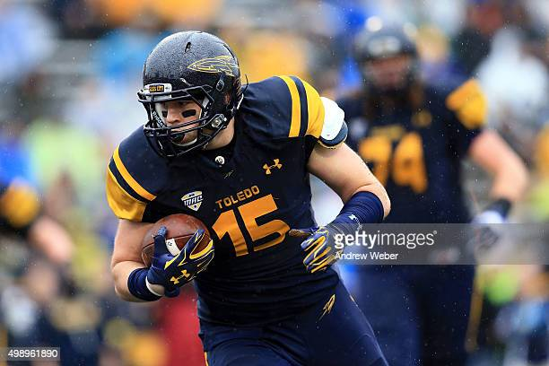 Tight end Alex Zmolik of the Toledo Rockets catches a pass for a touchdown during the first quarter against the Western Michigan Broncos at Glass...