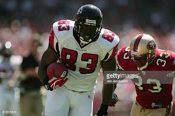 Tight end Alge Crumpler of the Atlanta Falcons evades safety Tony Parrish of the San Francisco 49ers during the game at 3Com Park on September 12,...