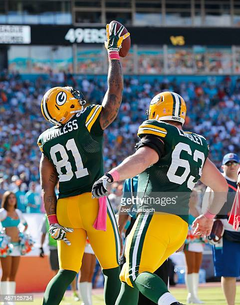 Tight end Andrew Quarless of the Green Bay Packers celebrates his game-winning touchdown catch against the Miami Dolphins in the fourth quarter...